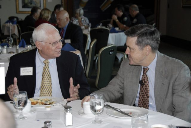 CAPE CANAVERAL, Fla. – Florida Rep. Ralph Poppell (left) talks with Kennedy Space Center Director Bob Cabana during the annual Community Leaders Breakfast held in the Debus Center at Kennedy Space Center's Visitor Complex. Community leaders, business executives, educators, community organizers and state and local government heard Cabana provide an overview of operations at the space center and a look ahead at upcoming missions and activities. Photo credit: NASA/Kim Shiflett KSC-2009-3304