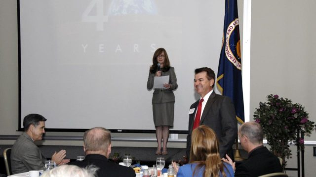 CAPE CANAVERAL, Fla. – NASA Kennedy Space Center's External Relations Director Lisa Malone introduces Florida Senator Thad Altman during the annual Community Leaders Breakfast held in the Debus Center at Kennedy Space Center's Visitor Complex.  Seated at far left is Center Director Bob Cabana.  Community leaders, business executives, educators, community organizers and state and local government representatives heard Cabana provide an overview of operations at the space center and a look ahead at upcoming missions and activities. Photo credit: NASA/Kim Shiflett KSC-2009-3305