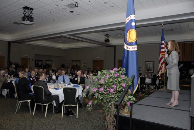 CAPE CANAVERAL, Fla. – NASA Kennedy Space Center's External Relations Director Lisa Malone hosts the annual Community Leaders Breakfast held in the Debus Center at Kennedy Space Center's Visitor Complex. On the right at the table at left are Florida Rep. Ralph Poppell and Center Director Bob Cabana.  Community leaders, business executives, educators, community organizers and state and local government heard Cabana provide an overview of operations at the space center and a look ahead at upcoming missions and activities. Photo credit: NASA/Kim Shiflett KSC-2009-3307
