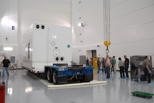 CAPE CANAVERAL, Fla. – The shipping container with NASA's Solar Dynamics Observatory, or SDO,  arrives at Astrotech Space Operations in Titusville, Fla.   SDO is the first space weather research network mission in NASA's Living With a Star Program.  The spacecraft's long-term measurements will give solar scientists in-depth information about changes in the sun's magnetic field and insight into how they affect Earth.  In preparation for its anticipated November launch, engineers will perform a battery of comprehensive tests to ensure SDO can withstand the stresses and vibrations of the launch itself, as well as what it will encounter in the space environment after launch.  Photo credit: NASA/Tim Jacobs KSC-2009-4013