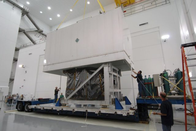 CAPE CANAVERAL, Fla. – At Astrotech Space Operations in Titusville, Fla., the shipping container cover is lifted from NASA's Solar Dynamics Observatory, or SDO. SDO is the first space weather research network mission in NASA's Living With a Star Program.  The spacecraft's long-term measurements will give solar scientists in-depth information about changes in the sun's magnetic field and insight into how they affect Earth.  In preparation for its anticipated November launch, engineers will perform a battery of comprehensive tests to ensure SDO can withstand the stresses and vibrations of the launch itself, as well as what it will encounter in the space environment after launch.  Photo credit: NASA/Tim Jacobs KSC-2009-4015