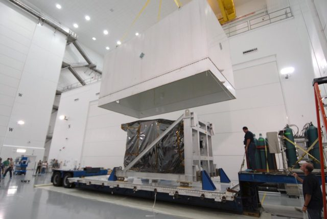 CAPE CANAVERAL, Fla. – At Astrotech Space Operations in Titusville, Fla., the shipping container cover is lifted from NASA's Solar Dynamics Observatory, or SDO. SDO is the first space weather research network mission in NASA's Living With a Star Program.  The spacecraft's long-term measurements will give solar scientists in-depth information about changes in the sun's magnetic field and insight into how they affect Earth.  In preparation for its anticipated November launch, engineers will perform a battery of comprehensive tests to ensure SDO can withstand the stresses and vibrations of the launch itself, as well as what it will encounter in the space environment after launch.  Photo credit: NASA/Tim Jacobs KSC-2009-4016