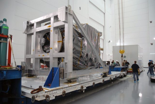 CAPE CANAVERAL, Fla. – At Astrotech Space Operations in Titusville, Fla.,  NASA's Solar Dynamics Observatory, or SDO, remains on the transporter after the shipping cover was removed.  SDO is the first space weather research network mission in NASA's Living With a Star Program.  The spacecraft's long-term measurements will give solar scientists in-depth information about changes in the sun's magnetic field and insight into how they affect Earth.  In preparation for its anticipated November launch, engineers will perform a battery of comprehensive tests to ensure SDO can withstand the stresses and vibrations of the launch itself, as well as what it will encounter in the space environment after launch.  Photo credit: NASA/Tim Jacobs KSC-2009-4018