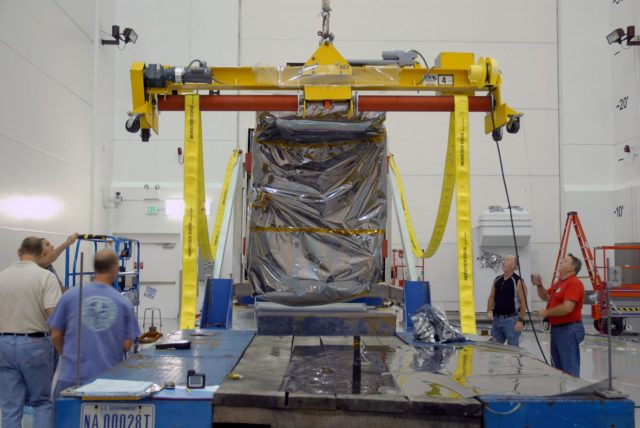 CAPE CANAVERAL, Fla. – At Astrotech Space Operations in Titusville, Fla., a hoist is attached to NASA's Solar Dynamics Observatory, or SDO, in order to lift and rotate it.  SDO is the first space weather research network mission in NASA's Living With a Star Program.  The spacecraft's long-term measurements will give solar scientists in-depth information about changes in the sun's magnetic field and insight into how they affect Earth.  In preparation for its anticipated November launch, engineers will perform a battery of comprehensive tests to ensure SDO can withstand the stresses and vibrations of the launch itself, as well as what it will encounter in the space environment after launch.   Photo credit: NASA/Cory Huston KSC-2009-4019