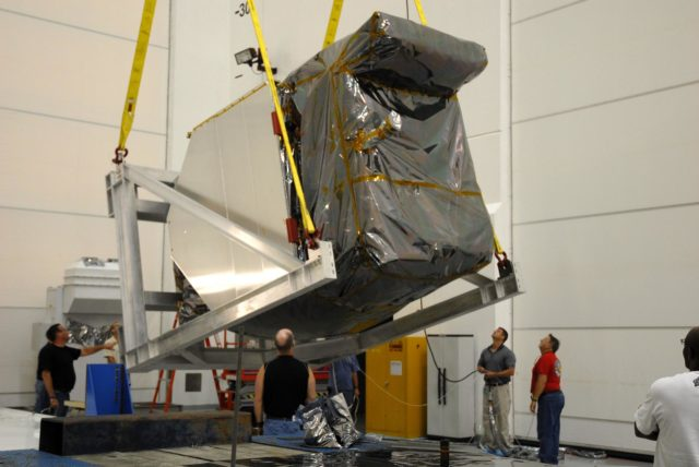 CAPE CANAVERAL, Fla. – At Astrotech Space Operations in Titusville, Fla., a hoist begins rotating NASA's Solar Dynamics Observatory, or SDO.  After rotation, the SDO will be moved to a work stand. SDO will be rotated and moved to a work stand. SDO is the first space weather research network mission in NASA's Living With a Star Program.  The spacecraft's long-term measurements will give solar scientists in-depth information about changes in the sun's magnetic field and insight into how they affect Earth.  In preparation for its anticipated November launch, engineers will perform a battery of comprehensive tests to ensure SDO can withstand the stresses and vibrations of the launch itself, as well as what it will encounter in the space environment after launch.   Photo credit: NASA/Cory Huston KSC-2009-4022