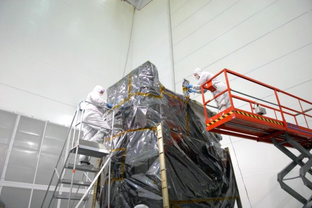 CAPE CANAVERAL, Fla. – At Astrotech Space Operations in Titusville, Fla., technicians remove the protective cover around NASA's Solar Dynamics Observatory, or SDO. SDO is the first space weather research network mission in NASA's Living With a Star Program.  The spacecraft's long-term measurements will give solar scientists in-depth information about changes in the sun's magnetic field and insight into how they affect Earth.  In preparation for its anticipated November launch, engineers will perform a battery of comprehensive tests to ensure SDO can withstand the stresses and vibrations of the launch itself, as well as what it will encounter in the space environment after launch.    Photo credit: NASA/Jim Grossmann KSC-2009-4035