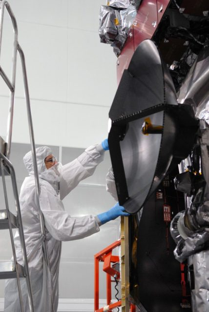CAPE CANAVERAL, Fla. – At Astrotech Space Operations in Titusville, Fla., a technician checks the antenna on NASA's Solar Dynamics Observatory, or SDO, after the protective cover was removed. SDO is the first space weather research network mission in NASA's Living With a Star Program.  The spacecraft's long-term measurements will give solar scientists in-depth information about changes in the sun's magnetic field and insight into how they affect Earth.  In preparation for its anticipated November launch, engineers will perform a battery of comprehensive tests to ensure SDO can withstand the stresses and vibrations of the launch itself, as well as what it will encounter in the space environment after launch.    Photo credit: NASA/Jim Grossmann KSC-2009-4038