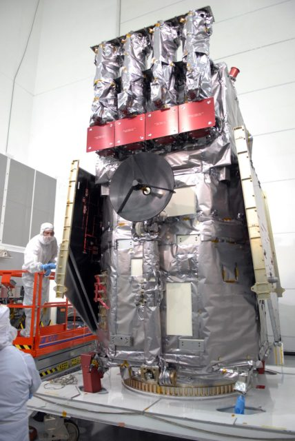 CAPE CANAVERAL, Fla. – At Astrotech Space Operations in Titusville, Fla., a technician checks a solar array on NASA's Solar Dynamics Observatory, or SDO, after the protective cover was removed. SDO is the first space weather research network mission in NASA's Living With a Star Program.  The spacecraft's long-term measurements will give solar scientists in-depth information about changes in the sun's magnetic field and insight into how they affect Earth.  In preparation for its anticipated November launch, engineers will perform a battery of comprehensive tests to ensure SDO can withstand the stresses and vibrations of the launch itself, as well as what it will encounter in the space environment after launch.    Photo credit: NASA/Jim Grossmann KSC-2009-4042
