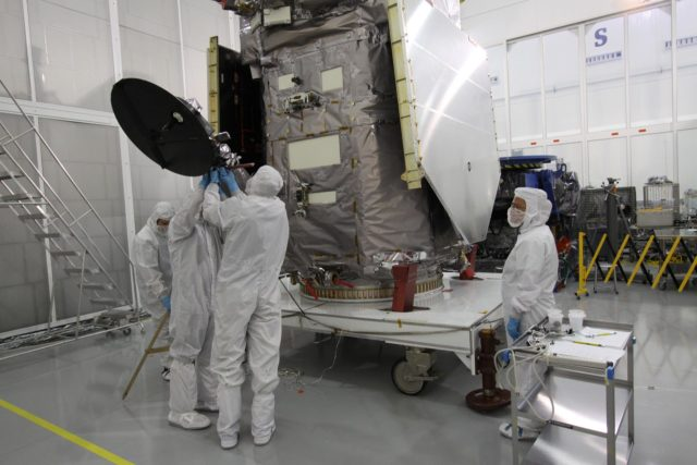 CAPE CANAVERAL, Fla. – Engineers at Astrotech Space Operations in Titusville, Fla.,  lower the high-gain antenna on the Solar Dynamics Observatory to gain access to the battery compartment for installation of the flight battery. SDO is the first space weather research network mission in NASA's Living With a Star Program.  The spacecraft's long-term measurements will give solar scientists in-depth information about changes in the sun's magnetic field and insight into how they affect Earth.  In preparation for its anticipated November launch, engineers will perform a battery of comprehensive tests to ensure SDO can withstand the stresses and vibrations of the launch itself, as well as what it will encounter in the space environment after launch.     Photo credit: NASA/Jack Pfaller KSC-2009-4064