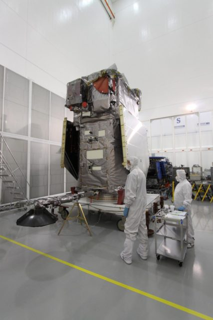 CAPE CANAVERAL, Fla. – At Astrotech Space Operations in Titusville, Fla.,  the lowered high-gain antenna on the Solar Dynamics Observatory will allow engineers access to the battery compartment in order to install the flight battery. SDO is the first space weather research network mission in NASA's Living With a Star Program.  The spacecraft's long-term measurements will give solar scientists in-depth information about changes in the sun's magnetic field and insight into how they affect Earth.  In preparation for its anticipated November launch, engineers will perform a battery of comprehensive tests to ensure SDO can withstand the stresses and vibrations of the launch itself, as well as what it will encounter in the space environment after launch.     Photo credit: NASA/Jack Pfaller KSC-2009-4067