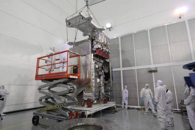 CAPE CANAVERAL, Fla. – At the Astrotech Payload Processing Facility in Titusville, Fla., the Solar Dynamics Observatory is fitted with a crane to lift it from the work stand.  The spacecraft will be moved onto a Ransome table that will allow it to be rotated in various directions for access to different areas of the spacecraft. SDO is the first space weather research network mission in NASA's Living With a Star Program.  The spacecraft's long-term measurements will give solar scientists in-depth information about changes in the sun's magnetic field and insight into how they affect Earth.  In preparation for its anticipated November launch, engineers will perform a battery of comprehensive tests to ensure SDO can withstand the stresses and vibrations of the launch itself, as well as what it will encounter in the space environment after launch.  Photo credit: NASA/Jack Pfaller KSC-2009-4262