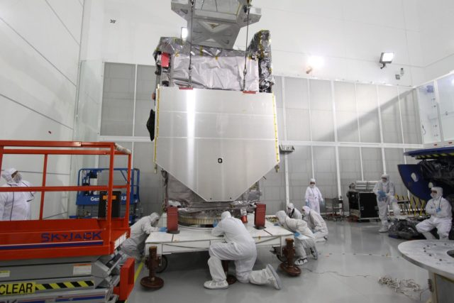 CAPE CANAVERAL, Fla. – At the Astrotech Payload Processing Facility in Titusville, Fla., technicians check the clearance as the Solar Dynamics Observatory is lifted from the stand.  The spacecraft is being moved onto a Ransome table that will allow it to be rotated in various directions for access to different areas of the spacecraft.  SDO is the first space weather research network mission in NASA's Living With a Star Program.  The spacecraft's long-term measurements will give solar scientists in-depth information about changes in the sun's magnetic field and insight into how they affect Earth.  In preparation for its anticipated November launch, engineers will perform a battery of comprehensive tests to ensure SDO can withstand the stresses and vibrations of the launch itself, as well as what it will encounter in the space environment after launch.  Photo credit: NASA/Jack Pfaller KSC-2009-4264