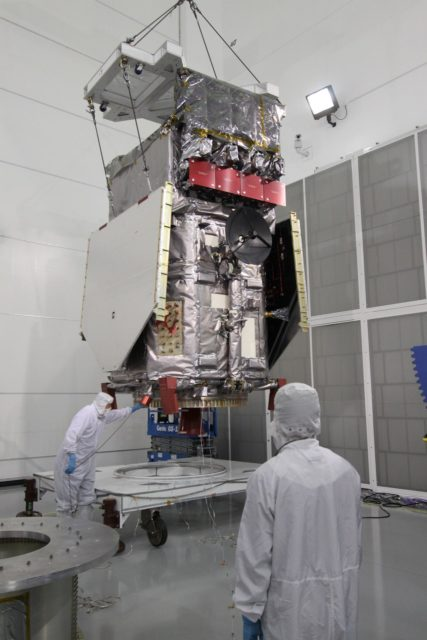 CAPE CANAVERAL, Fla. – At the Astrotech Payload Processing Facility in Titusville, Fla.,  the Solar Dynamics Observatory is lifted from the work stand under the guidance of technicians. The spacecraft is being moved onto a Ransome table that will allow it to be rotated in various directions for access to different areas of the spacecraft.  SDO is the first space weather research network mission in NASA's Living With a Star Program.  The spacecraft's long-term measurements will give solar scientists in-depth information about changes in the sun's magnetic field and insight into how they affect Earth.  In preparation for its anticipated November launch, engineers will perform a battery of comprehensive tests to ensure SDO can withstand the stresses and vibrations of the launch itself, as well as what it will encounter in the space environment after launch.  Photo credit: NASA/Jack Pfaller KSC-2009-4265