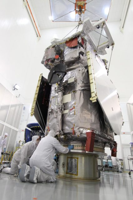 CAPE CANAVERAL, Fla. – At the Astrotech Payload Processing Facility in Titusville, Fla.,  technicians check the Solar Dynamics Observatory after it was lifted from its work stand.  The spacecraft is being moved onto a Ransome table that will allow it to be rotated in various directions for access to different areas of the spacecraft.  SDO is the first space weather research network mission in NASA's Living With a Star Program.  The spacecraft's long-term measurements will give solar scientists in-depth information about changes in the sun's magnetic field and insight into how they affect Earth.  In preparation for its anticipated November launch, engineers will perform a battery of comprehensive tests to ensure SDO can withstand the stresses and vibrations of the launch itself, as well as what it will encounter in the space environment after launch.  Photo credit: NASA/Jack Pfaller KSC-2009-4266
