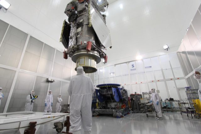 CAPE CANAVERAL, Fla. – At the Astrotech Payload Processing Facility in Titusville, Fla.,  the Solar Dynamics Observatory is  moved across the floor toward the Ransome table in the background.  The table will be used to rotate the spacecraft in various directions for access to different areas of the spacecraft. SDO is the first space weather research network mission in NASA's Living With a Star Program.  The spacecraft's long-term measurements will give solar scientists in-depth information about changes in the sun's magnetic field and insight into how they affect Earth.  In preparation for its anticipated November launch, engineers will perform a battery of comprehensive tests to ensure SDO can withstand the stresses and vibrations of the launch itself, as well as what it will encounter in the space environment after launch.  Photo credit: NASA/Jack Pfaller KSC-2009-4267