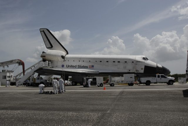 """CAPE CANAVERAL, Fla. –  A large team of specialists works methodically through procedures to """"safe"""" Endeavour as it sits on the runway after landing to complete the 16-day, 6.5-million mile journey on the STS-127 mission to the International Space Station. Trucks are positioned at the shuttle's nose and tail to drain away hazardous chemicals that may still be inside systems such as the thrusters. Later, the astronauts are expected to walk around Endeavour.  Main gear touchdown was at 10:48:08 a.m. EDT. Nose gear touchdown was at 10:48:21 a.m. and wheels stop was at 10:49:13 a.m. Endeavour delivered the Japanese Experiment Module's Exposed Facility and the Experiment Logistics Module-Exposed Section to the International Space Station. The mission was the 29th flight to the station, the 23rd flight of Endeavour and the 127th in the Space Shuttle Program, as well as the 71st landing at Kennedy.   Photo credit: NASA/Kim Shiflett KSC-2009-4307"""
