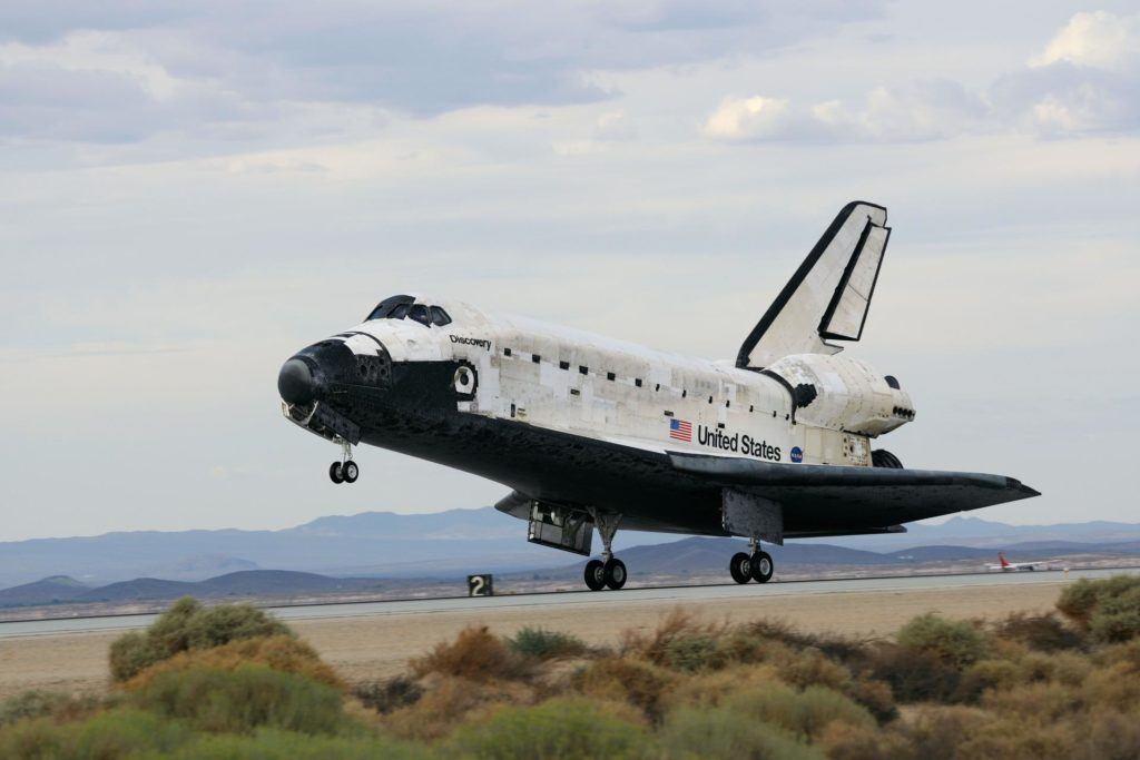 STS128-S-046 (11 Sept. 2009) --- Space Shuttle Discovery?s main landing gear touches down at NASA's Dryden Flight Research Center at Edwards Air Force Base in California, concluding a successful mission to the International Space Station. Onboard are NASA astronauts Rick Sturckow, commander; Kevin Ford, pilot; John ?Danny? Olivas, Patrick Forrester, Jose Hernandez and Tim Kopra, all mission specialists; along with European Space Agency astronaut Christer Fuglesang, mission specialist. Discovery landed at 5:53 p.m. (PDT) on Sept. 11, 2009 to end the STS-128 mission, completing its almost 14-day journey of more than 5.7 million miles in space. The landing was diverted to California due to marginal weather at the Kennedy Space Center. Discovery?s mission featured three spacewalks and the delivery of two refrigerator-sized science racks to the space station. One rack will be used to conduct experiments on materials such as metals, glasses and ceramics. The results from these experiments could lead to the development of better materials on Earth. The other rack will be used for fluid physics research. Understanding how fluids react in microgravity could lead to improved designs for fuel tanks, water systems and other fluid-based systems. sts128-s-046