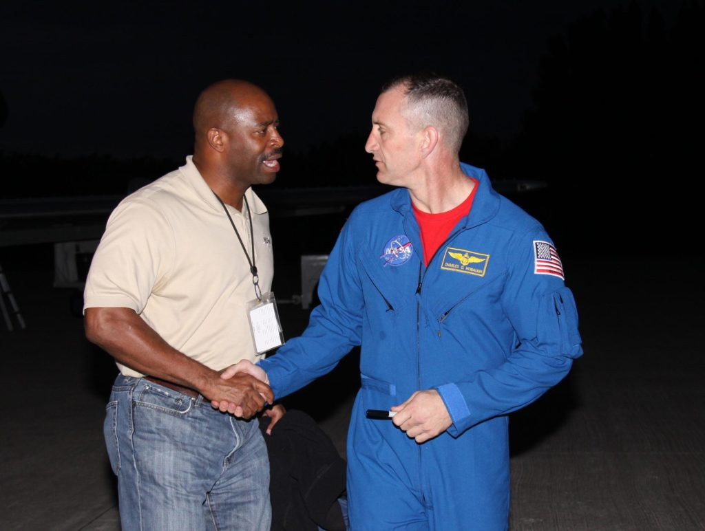 CAPE CANAVERAL, Fla. - STS-129 Mission Specialist Leland Melvin greets Commander Charles O. Hobaugh upon their arrival at the Shuttle Landing Facility at NASA's Kennedy Space Center in Florida.  The six astronauts for space shuttle Atlantis' STS-129 mission are at Kennedy for their launch dress rehearsal, the Terminal Countdown Demonstration Test.    Additional training associated with the test was done last month, but the simulated countdown was postponed because of a scheduling conflict with the launch of NASA's Ares I-X test rocket.  Launch of Atlantis on its STS-129 mission to the International Space Station is set for Nov. 16. On STS-129, the crew will deliver to the station two spare gyroscopes, two nitrogen tank assemblies, two pump modules, an ammonia tank assembly and a spare latching end effector for the station's robotic arm.  For information on the STS-129 mission objectives and crew, visit http://www.nasa.gov/mission_pages/shuttle/shuttlemissions/sts129/index.html. Photo credit: NASA/Troy Cryder KSC-2009-6037