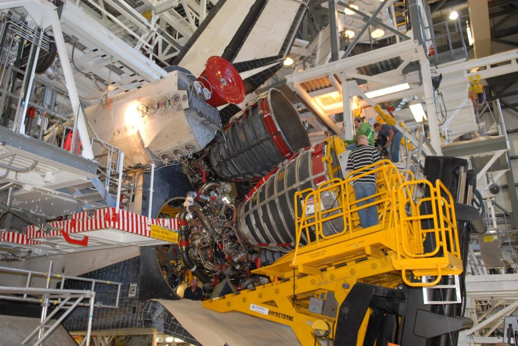 CAPE CANAVERAL, Fla. – A Pratt & Whitney Rocketdyne technician carefully maneuvers a space shuttle main engine into position on space shuttle Endeavour in Orbiter Processing Facility Bay 2 at NASA's Kennedy Space Center in Florida.  The engine will fly on the shuttle's STS-130 mission to the International Space Station.    Even though this engine weighs one-seventh as much as a locomotive engine, its high-pressure fuel pump alone delivers as much horsepower as 28 locomotives, while its high-pressure oxidizer pump delivers the equivalent horsepower of an additional 11 locomotives. The maximum equivalent horsepower developed by the shuttle's three main engines is more than 37 million horsepower.  Endeavour is targeted to launch Feb. 4, 2010. Photo credit: NASA/Jim Grossmann KSC-2009-6125
