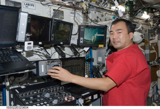 Noguchi works at Canadarm2 Workstation in the U.S. Laboratory during Expedition 22