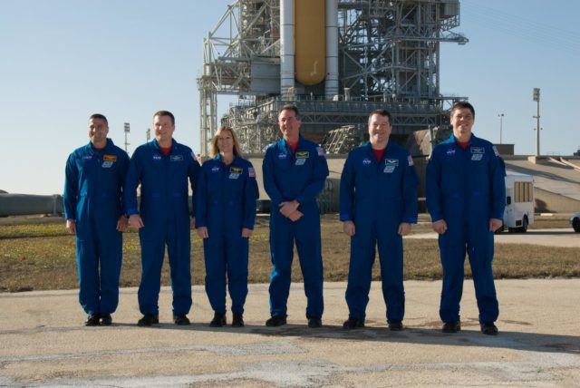 CAPE CANAVERAL, Fla. - At Launch Pad 39A at NASA's Kennedy Space Center in Florida, the crew members of space shuttle Endeavour's STS-130 mission pose for a group portrait following a question-and-answer session with the media.  From left are Commander George Zamka; Pilot Terry Virts; and Mission Specialists Kathryn Hire, Stephen Robinson, Nicholas Patrick and Robert Behnken.    The crew members of space shuttle Endeavour's upcoming mission are at Kennedy for training related to their launch dress rehearsal, the Terminal Countdown Demonstration Test.  The primary payload on STS-130 is the International Space Station's Node 3, Tranquility, a pressurized module that will provide room for many of the station's life support systems. Attached to one end of Tranquility is a cupola, a unique work area with six windows on its sides and one on top.  Endeavour's launch is targeted for Feb. 7.  For information on the STS-130 mission and crew, visit http://www.nasa.gov/mission_pages/shuttle/shuttlemissions/sts130/index.html.  Photo credit: NASA/Kim Shiflett KSC-2010-1334