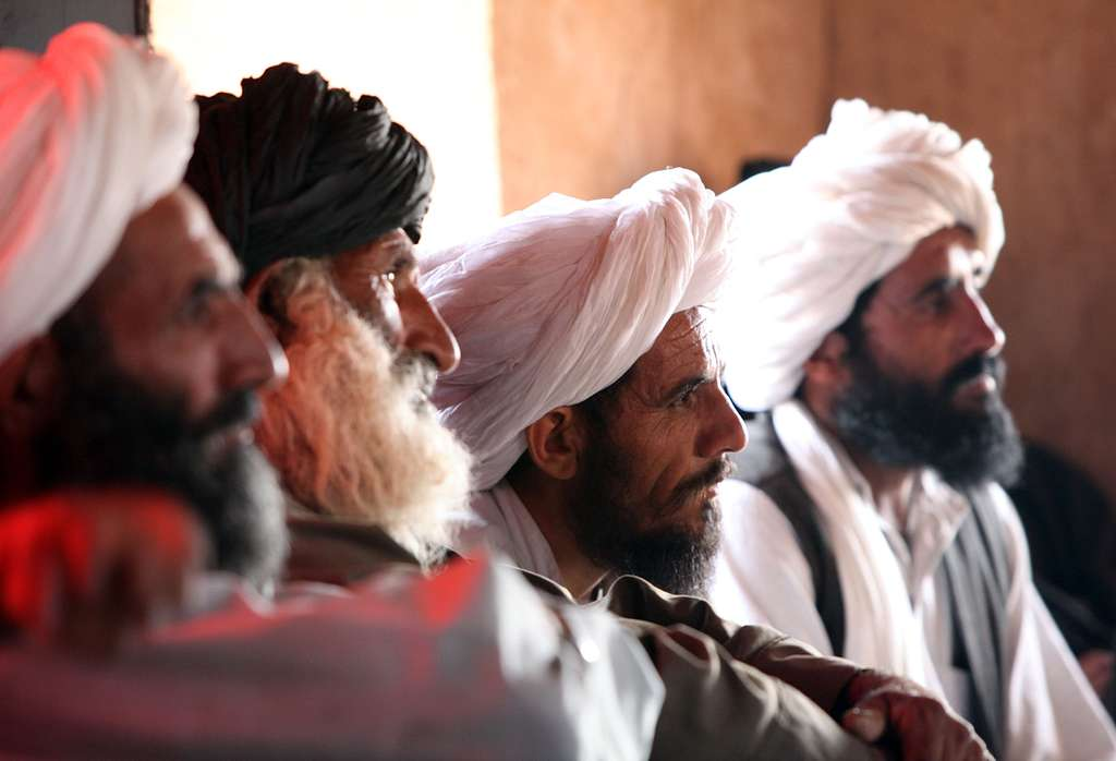 Afghans listen in on a council meeting with Marines