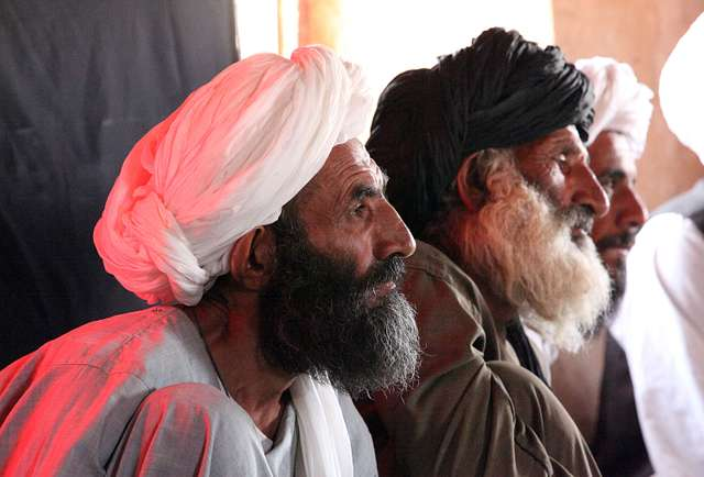 Afghans listen intently to council meeting with Marines