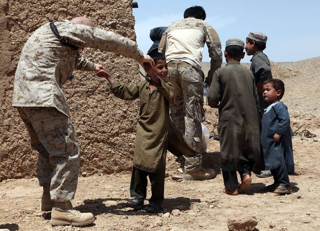 Marines play games with Afghan children