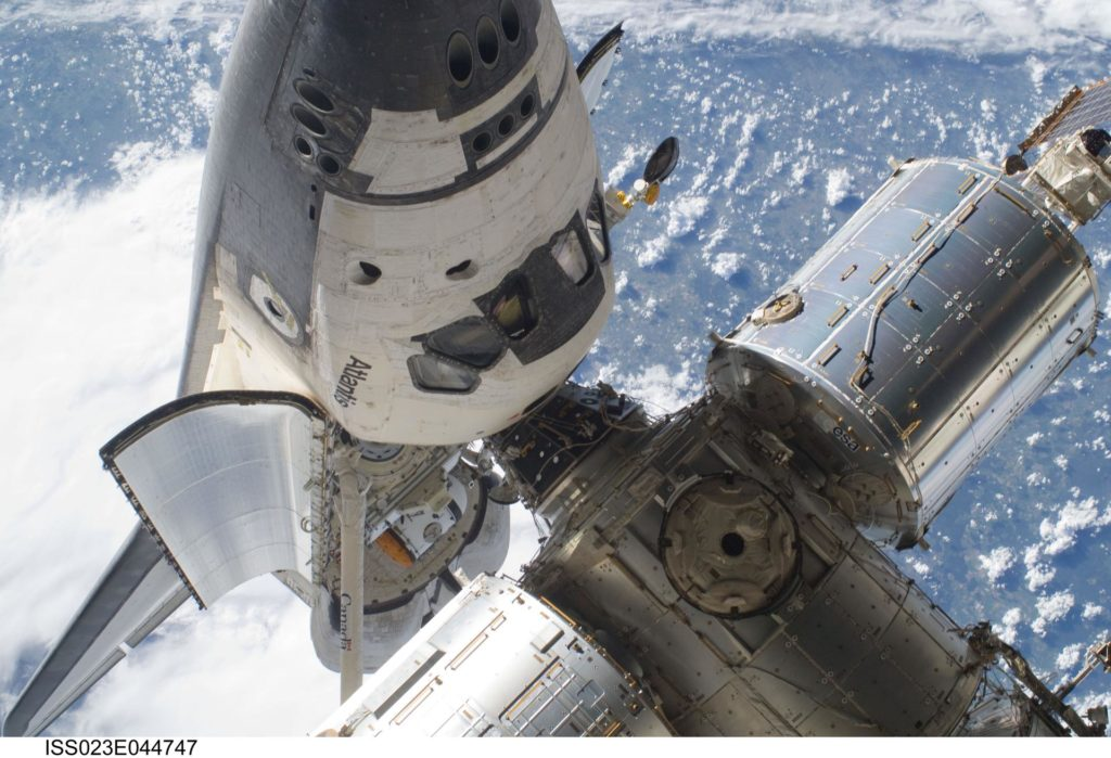 View of the FWD ISS and docked Atlantis during EVA 1