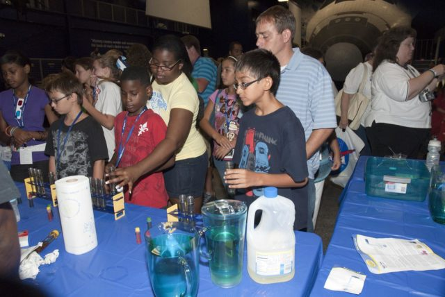 "CAPE CANAVERAL, Fla. -- At the Astronaut Hall of Fame near the Kennedy Space Center Visitor Complex in Florida, fifth- through eighth-grade students and their parents create lava lamps and slime in a fluids experiment during the last NASA family education night event. Other activities included ""gee-whiz"" presentations, astronaut appearances, a hovercraft, vortex cannon and alternative fuel vehicles, which promote science, technology, engineering and mathematics (STEM) education.      The event is part of NASA's Summer of Innovation initiative to provide interactive learning experiences to middle school students nationwide during the summer months. The program is a cornerstone of the Educate to Innovate campaign announced by President Barack Obama in November 2009. Photo credit: NASA/Charisse Nahser KSC-2010-4519"