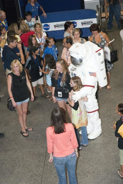 "CAPE CANAVERAL, Fla. -- At the Astronaut Hall of Fame near the Kennedy Space Center Visitor Complex in Florida, fifth- through eighth-grade students and their parents meet a space person during the last NASA family education night event. Other activities included ""gee-whiz"" presentations, astronaut appearances, a hovercraft, vortex cannon and alternative fuel vehicles, which promote science, technology, engineering and mathematics (STEM) education.    The event is part of NASA's Summer of Innovation initiative to provide interactive learning experiences to middle school students nationwide during the summer months. The program is a cornerstone of the Educate to Innovate campaign announced by President Barack Obama in November 2009. Photo credit: NASA/Charisse Nahser KSC-2010-4527"