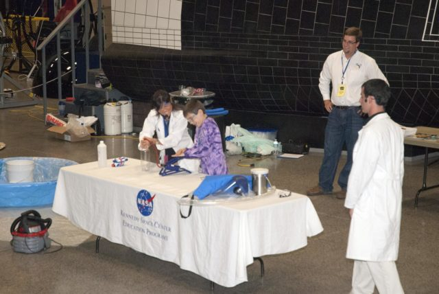 "CAPE CANAVERAL, Fla. -- At the Astronaut Hall of Fame near the Kennedy Space Center Visitor Complex in Florida, a student participates in a ""cloud-in-a-bottle"" demonstration during the last NASA family education night event. Activities for fifth- through eighth-grade students and their parents included ""gee-whiz"" presentations, astronaut appearances, a hovercraft, vortex cannon and alternative fuel vehicles, which promote science, technology, engineering and mathematics (STEM) education.    The event is part of NASA's Summer of Innovation initiative to provide interactive learning experiences to middle school students nationwide during the summer months. The program is a cornerstone of the Educate to Innovate campaign announced by President Barack Obama in November 2009. Photo credit: NASA/Charisse Nahser KSC-2010-4528"