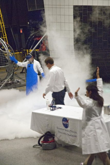"CAPE CANAVERAL, Fla. -- At the Astronaut Hall of Fame near the Kennedy Space Center Visitor Complex in Florida, fifth- through eighth-grade students and their parents watch a liquid nitrogen experiment during the last NASA family education night event. Other activities included ""gee-whiz"" presentations, astronaut appearances, a hovercraft, vortex cannon and alternative fuel vehicles, which promote science, technology, engineering and mathematics (STEM) education.    The event is part of NASA's Summer of Innovation initiative to provide interactive learning experiences to middle school students nationwide during the summer months. The program is a cornerstone of the Educate to Innovate campaign announced by President Barack Obama in November 2009. Photo credit: NASA/Charisse Nahser KSC-2010-4529"