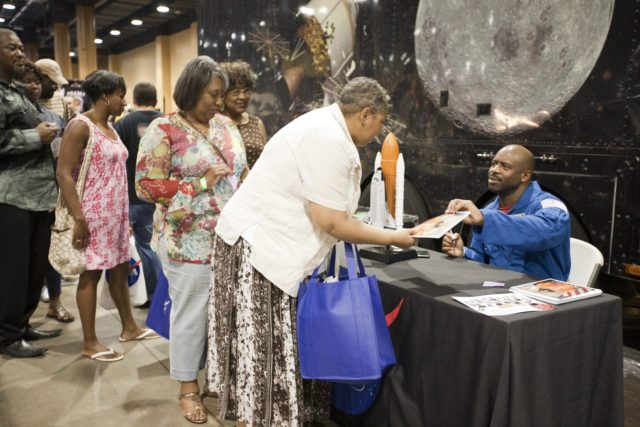 """ORLANDO, Fla. -- Attendees of the 2010 Tom Joyner Family Reunion stand in line to receive an autograph from NASA astronaut Leland Melvin at the Gaylord Palms Convention Center in Orlando, Fla. To encourage student attendees to focus on pursuing careers in science, technology, engineering and mathematics (STEM), NASA featured some of its greatest legends and trailblazers during a panel discussion at the reunion event.     NASA's Education Office sponsored the panel discussion and educational activities as part of the agency's """"Summer of Innovation"""" initiative and the federal """"Educate to Innovate"""" campaign. Photo credit: NASA/Amanda Diller KSC-2010-4568"""