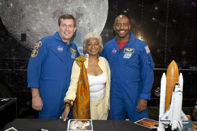"""ORLANDO, Fla. -- During the 2010 Tom Joyner Family Reunion, NASA astronaut Mike Foreman, left, space activist and actress Nichelle Nichols, and NASA astronaut Leland Melvin pose for a photo at the Gaylord Palms Convention Center in Orlando, Fla. To encourage student attendees to focus on pursuing careers in science, technology, engineering and mathematics (STEM), NASA featured some of its greatest legends and trailblazers during a panel discussion at the reunion event. In the 1960s, Nichols played communications officer Lieutenant Uhura in the Star Trek television series. Foreman and Melvin are both veterans of two space shuttle missions.    NASA's Education Office sponsored the panel discussion and educational activities as part of the agency's """"Summer of Innovation"""" initiative and the federal """"Educate to Innovate"""" campaign. Photo credit: NASA/Amanda Diller KSC-2010-4572"""