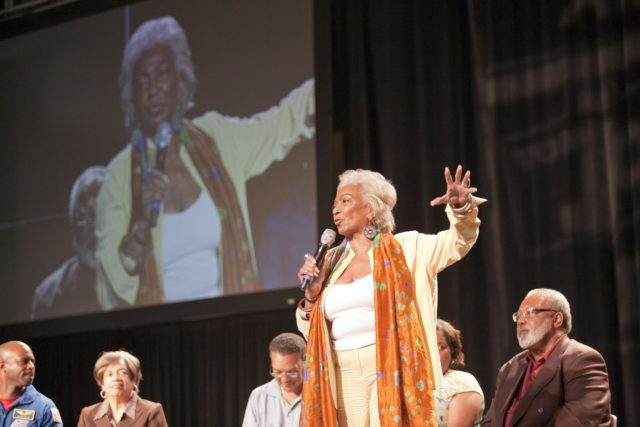 """ORLANDO, Fla. -- During the 2010 Tom Joyner Family Reunion, space activist and actress Nichelle Nichols talks to attendees at the Gaylord Palms Convention Center in Orlando, Fla. To encourage student attendees to focus on pursuing careers in science, technology, engineering and mathematics (STEM), NASA featured some of its greatest legends and trailblazers during a panel discussion at the reunion event. In the 1960s, Nichols played communications officer Lieutenant Uhura in the Star Trek television series. Other panel members included NASA astronaut Leland Melvin, Christine Darden, Lew Braxton, Robyn Gordon and Jim Jennings.    NASA's Education Office sponsored the panel discussion and educational activities as part of the agency's """"Summer of Innovation"""" initiative and the federal """"Educate to Innovate"""" campaign. Photo credit: NASA/Amanda Diller KSC-2010-4575"""