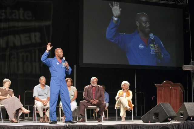 """ORLANDO, Fla. -- During the 2010 Tom Joyner Family Reunion, NASA astronaut Leland Melvin talks to attendees at the Gaylord Palms Convention Center in Orlando, Fla. To encourage student attendees to focus on pursuing careers in science, technology, engineering and mathematics (STEM), NASA featured some of its greatest legends and trailblazers during a panel discussion at the reunion event. Panel members, sitting from left, are Christine Darden, Lew Braxton, Robyn Gordon, Jim Jennings, and space activist and actress Nichelle Nichols.    NASA's Education Office sponsored the panel discussion and educational activities as part of the agency's """"Summer of Innovation"""" initiative and the federal """"Educate to Innovate"""" campaign. Photo credit: NASA/Amanda Diller KSC-2010-4577"""