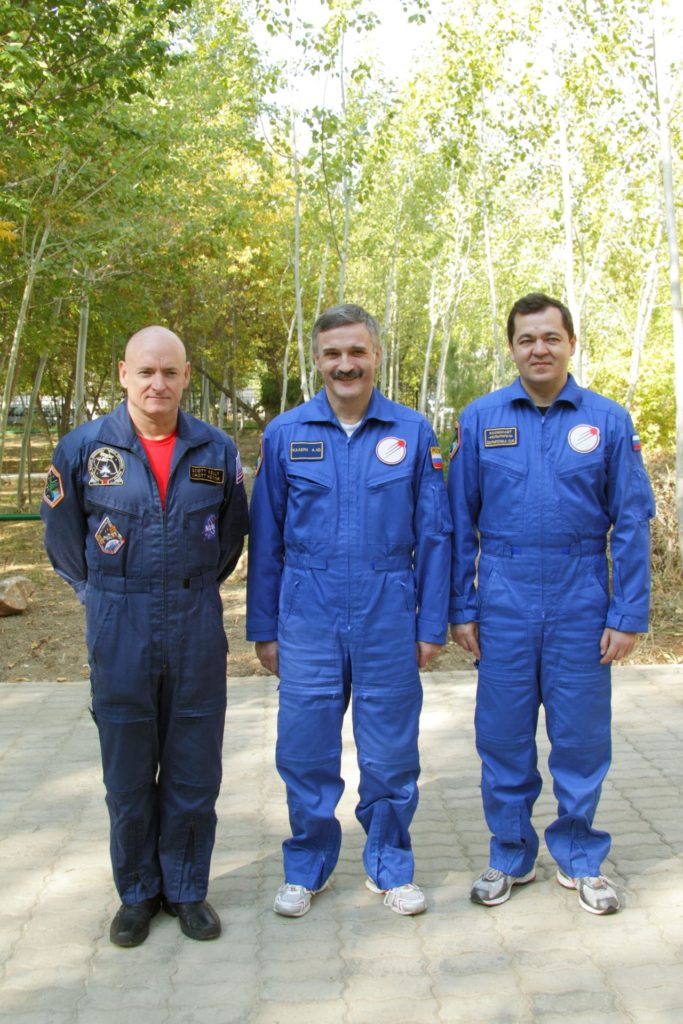At the Baikonur Cosmodrome in Kazakhstan, the prime crew of Expedition 25 posed for a picture after conducting the traditional raising of flags outside their Cosmonaut Hotel crew quarters September 27, 2010. From left to right are Flight Engineers Scott Kelly of NASA, Alexander Kaleri and Oleg Skripochka. The three crewmembers are completing training for their launch October 8 in the Soyuz TMA-01M spacecraft to the International Space Station.   Credit: NASA/Victor Zelentsov jsc2010e167403