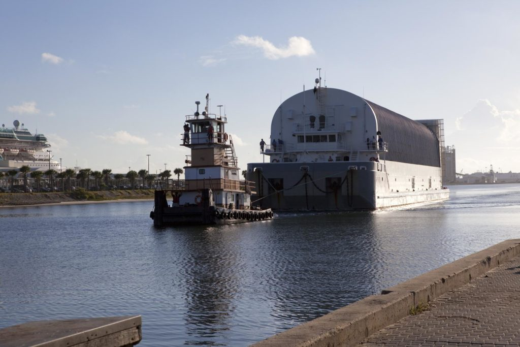 CAPE CANAVERAL, Fla. -- A tug boat pulls the Space Shuttle Program's last external fuel tank, ET-122, toward the Turn Basin at NASA's Kennedy Space Center in Florida. The tank traveled 900 miles by sea from NASA's Michoud Assembly Facility in New Orleans aboard the Pegasus Barge. Next, the tank will be offloaded and moved to Kennedy's Vehicle Assembly Building where it eventually will be attached to space shuttle Endeavour for the STS-134 mission to the International Space Station. STS-134, targeted to launch in Feb., 2011, currently is scheduled to be the last mission in the Space Shuttle Program.        The tank, which is the largest element of the space shuttle stack, was damaged during Hurricane Katrina in August 2005 and restored to flight configuration by Lockheed Martin Space Systems Company employees. Photo credit: NASA/Frankie Martin KSC-2010-4834