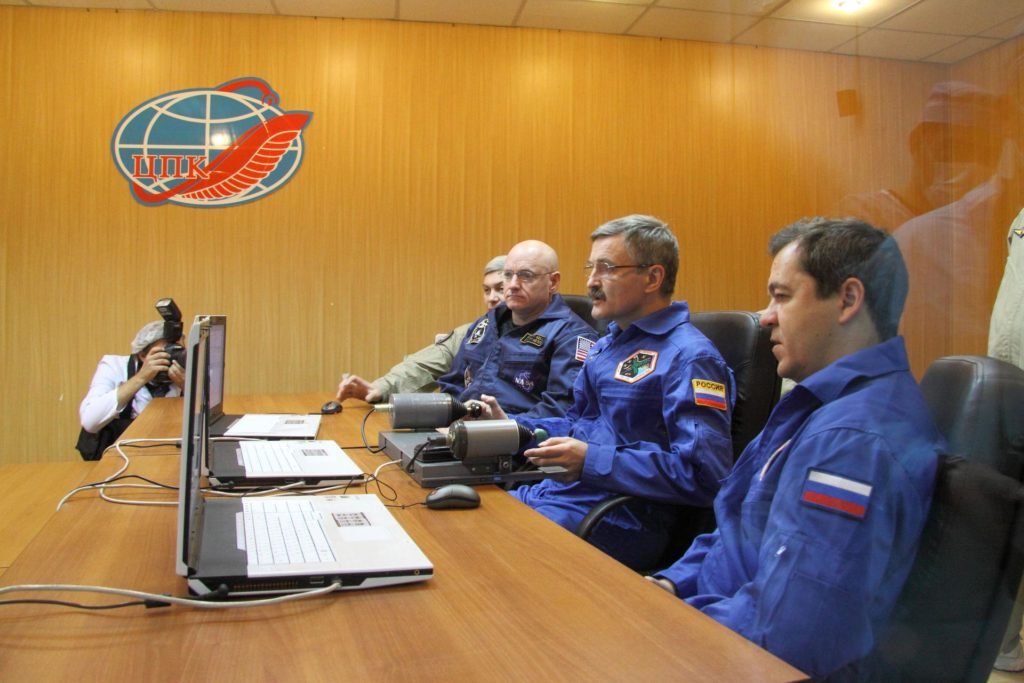 At their crew quarters in Baikonur, Kazakhstan, Expedition 25 Flight Engineers Scott Kelly of NASA (left), Alexander Kaleri (center) and Oleg Skripochka review rendezvous and docking programs on a laptop simulator October 2, 2010 as they prepare for their launch October 8 in the Soyuz TMA-01M spacecraft to the International Space Station.  Credit: NASA/Victor Zelentsov jsc2010e170861