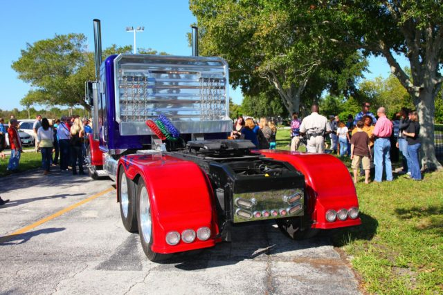 "CAPE CANAVERAL, Fla. -- NASA Kennedy Space Center employees in Florida were provided a unique photo opportunity on Oct. 8 from some of the robot 'stars' of the upcoming movie, ""Transformers 3."" Paramount Pictures filmed scenes for the movie at Kennedy from Oct. 4 through 8. As a show of appreciation for sharing the space center with the ""Transformers 3"" cast and crew, Kennedy employees and their families were invited to see two Transformers characters, Optimus Prime and Bumblebee, in their vehicle form, on display outside Kennedy Space Center Visitor Complex. In this image 'Optimus Prime' takes center stage. ""Transformers 3"" is due out in theaters summer 2011. Photo credit: NASA/Frank Michaux KSC-2010-5028"