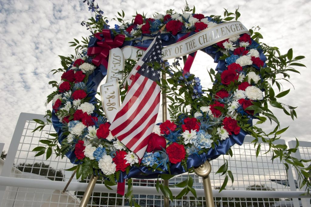 CAPE CANAVERAL, Fla. -- A wreath is displayed at the foot of the Space Mirror Memorial at the Kennedy Space Center Visitor Complex in Florida during a ceremony to honor space shuttle Challenger's STS-51L crew members who gave their lives for while furthering the cause of exploration and discovery. 2011 marks the 25th anniversary of the loss of Challenger, which broke apart over the Atlantic Ocean 73 seconds into flight on Jan. 28, 1986.  Photo credit: NASA/Kim Shiflett KSC-2011-1228