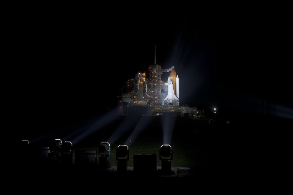 """CAPE CANAVERAL, Fla. -- At NASA's Kennedy Space Center in Florida, space shuttle Discovery is illuminated by bright xenon lights on Launch Pad 39A after the rotating service structure was moved away. The structure provides weather protection and access to the shuttle while it awaits lift off on the pad. RSS """"rollback,"""" as it's called, began at 8:02 p.m. EST on Feb. 23 and wrapped up at 8:37 p.m.           Scheduled to lift off Feb. 24 at 4:50 p.m. EST, Discovery and its six-member crew will deliver the Permanent Multipurpose Module, packed with supplies and critical spare parts, as well as Robonaut 2, the dexterous humanoid astronaut helper, to the International Space Station. Discovery, which will fly its 39th mission, is scheduled to be retired following STS-133. This will be the 133rd Space Shuttle Program mission and the 35th shuttle voyage to the space station. For more information on the STS-133 mission, visit www.nasa.gov/mission_pages/shuttle/shuttlemissions/sts133/. Photo credit: NASA/Frankie Martin KSC-2011-1589"""