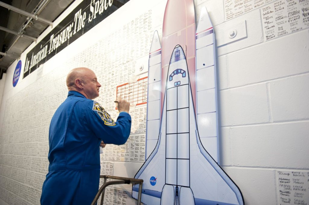 CAPE CANAVERAL, Fla. -- STS-134 Commander Mark Kelly signs the space shuttle wall tribute in the Vehicle Assembly Building at NASA's Kennedy Space Center in Florida. Kennedy employees who have supported the Space Shuttle Program throughout the last 30 years have been signing the wall as a tribute to the program.       Endeavour's six crew members are at Kennedy for the launch countdown dress rehearsal called the Terminal Countdown Demonstration Test (TCDT) and related training. Endeavour is targeted to launch April 19 at 7:48 p.m. EDT on its final spaceflight mission. For more information visit, www.nasa.gov/mission_pages/shuttle/shuttlemissions/sts134/index.html. Photo credit: NASA/Kim Shiflett KSC-2011-2616