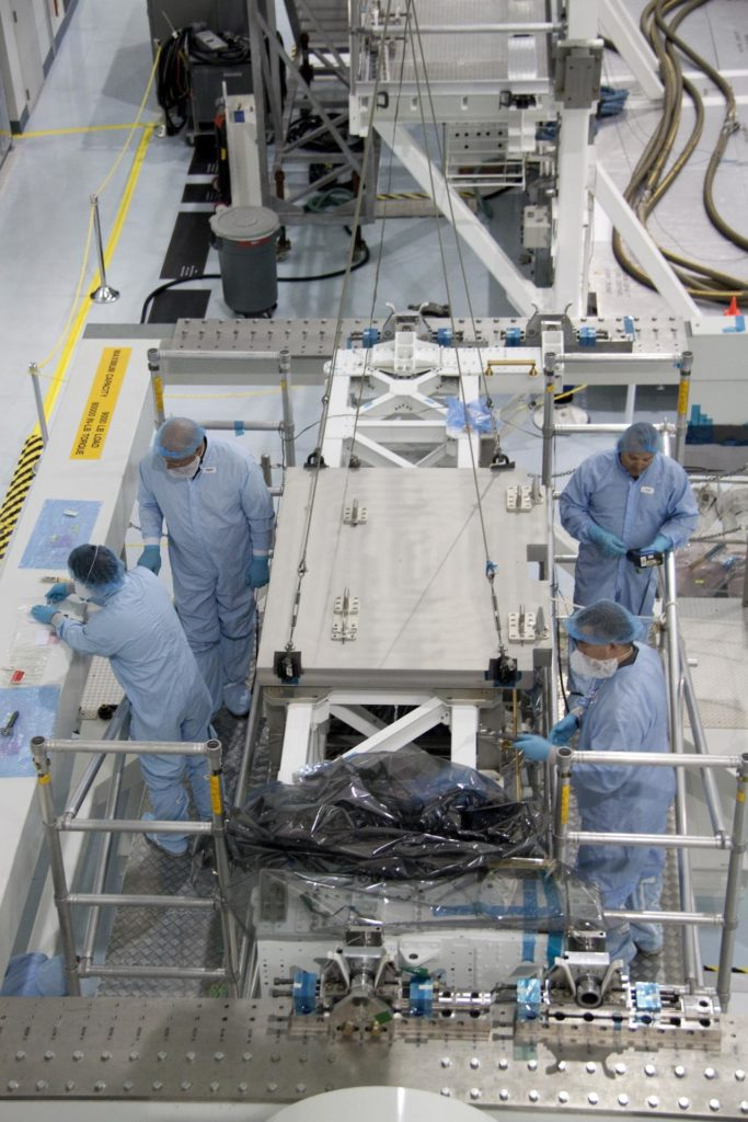 CAPE CANAVERAL, Fla. - In the Space Station Processing Facility at NASA's Kennedy Space Center in Florida, technicians secure the pump module assembly plate into position onto the Lightweight Multi-Purpose Experiment Support Structure Carrier, or LMC. The module assembly will be used to secure the return of a failed ammonia pump module in shuttle Atlantis' payload bay. Atlantis and its payload are being prepared for the STS-135 mission, which will deliver the Raffaello multipurpose logistics module packed with supplies, logistics and spare parts to the International Space Station. STS-135 is targeted to launch June 28, and will be the last spaceflight for the Space Shuttle Program. Photo credit: NASA/Jack Pfaller KSC-2011-2987