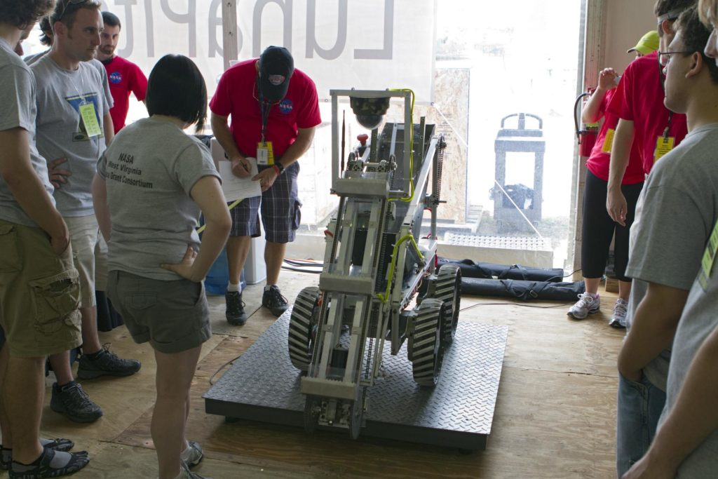 CAPE CANAVERAL, Fla. -- University students prepare for NASA's second annual Lunabotics Mining Competition at the Kennedy Space Center Visitor Complex in Florida.           Thirty-six teams of undergraduate and graduate students from the United States, Bangladesh, Canada, Colombia and India will participate in NASA's Lunabotics Mining Competition May 26 - 28. The competition is designed to engage and retain students in science, technology, engineering and mathematics (STEM). Teams will maneuver their remote controlled or autonomous excavators, called lunabots, in about 60 tons of ultra-fine simulated lunar soil, called BP-1. The competition is an Exploration Systems Mission Directorate project managed by Kennedy's Education Division. The event also provides a competitive environment that could result in innovative ideas and solutions for NASA's future excavation of the moon. Photo credit: NASA/Cory Huston KSC-2011-3939