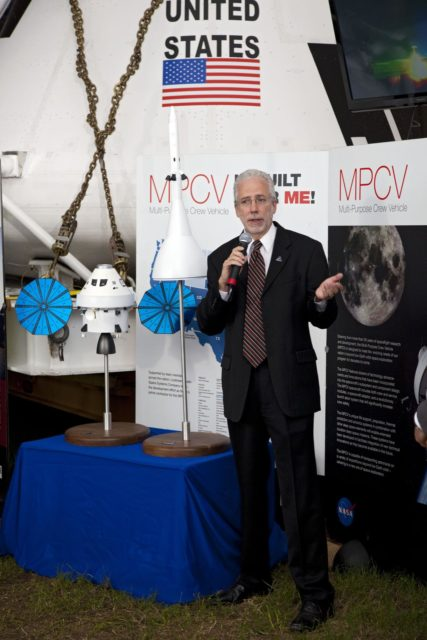 CAPE CANAVERAL, Fla. -- A media event was held on the grounds near the Press Site at NASA's Kennedy Space Center in Florida where a Multi-Purpose Crew Vehicle (MPCV) is on display. The MPCV is based on the Orion design requirements for traveling beyond low Earth orbit and will serve as the exploration vehicle that will carry the crew to space, provide emergency abort capability, sustain the crew during the space travel, and provide safe re-entry from deep space return velocities. Seen here is Mark Geyer, Multi-Purpose Crew Vehicle program manager speaking to media during a question-and-answer session. Photo credit: NASA/Frankie Martin KSC-2011-5112