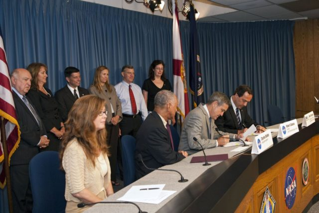 "CAPE CANAVERAL, Fla. -- NASA and Sierra Nevada Space Systems (SNSS) of Sparks, Nev., sign a Space Act Agreement that will offer the company technical capabilities from Kennedy Space Center's uniquely skilled work force. Sitting, from left, are Kennedy Public Affairs Director Lisa Malone; NASA Administrator Charlie Bolden; Kennedy Center Director Bob Cabana; and Mark Sirangelo, head of Sierra Nevada. Standing, from left, are Frank DiBello, president of Space Florida; Joyce Riquelme, manager of Kennedy's Center Planning and Development Office; John Curry, director of Sierra Nevada's Systems Integration, Test and Operations; Kennedy Deputy Director Janet Petro; Jim Voss, vice president of Sierra Nevada's Space Exploration Systems; and Merri Sanchez, senior director of Sierra Nevada's Space Exploration Systems. Kennedy will help Sierra Nevada with the ground operations support of its lifting body reusable spacecraft called ""Dream Chaser,"" which resembles a smaller version of the space shuttle orbiter.          The spacecraft would carry as many as seven astronauts to the space station. Through the new agreement, Kennedy's work force will use its experience of processing the shuttle fleet for 30 years to help Sierra Nevada define and execute Dream Chaser's launch preparations and post-landing activities. In 2010 and 2011, Sierra Nevada was awarded grants as part of the initiative to stimulate the private sector in developing and demonstrating human spaceflight capabilities for NASA's Commercial Crew Program. The goal of the program, which is based in Florida at Kennedy, is to facilitate the development of a U.S. commercial crew space transportation capability by achieving safe, reliable and cost-effective access to and from the space station and future low Earth orbit destinations. Photo credit: NASA/Jim Grossmann KSC-2011-5116"