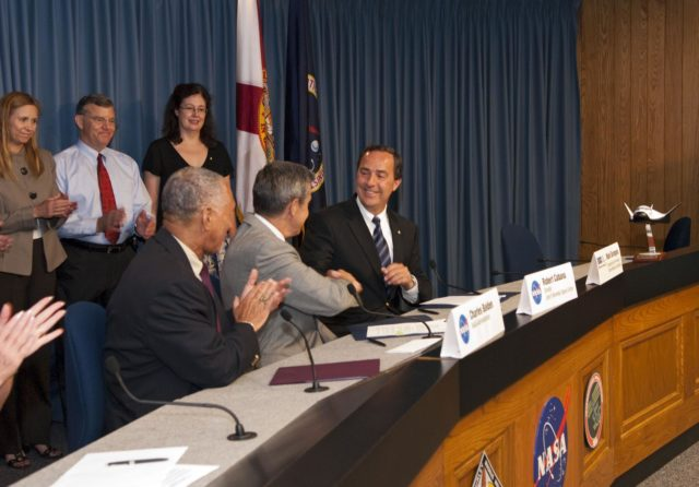 "CAPE CANAVERAL, Fla. -- NASA and Sierra Nevada Space Systems (SNSS) of Sparks, Nev., enter into a Space Act Agreement that will offer the company technical capabilities from Kennedy Space Center's uniquely skilled work force. Sitting, from left, are NASA Administrator Charlie Bolden; Kennedy Center Director Bob Cabana; and Mark Sirangelo, head of Sierra Nevada. Standing, from left, Kennedy Deputy Director Janet Petro; Jim Voss, vice president of Sierra Nevada's Space Exploration Systems; and Merri Sanchez, senior director of Sierra Nevada's Space Exploration Systems. Kennedy will help Sierra Nevada with the ground operations support of its lifting body reusable spacecraft called ""Dream Chaser,"" which resembles a smaller version of the space shuttle orbiter.        The spacecraft would carry as many as seven astronauts to the space station. Through the new agreement, Kennedy's work force will use its experience of processing the shuttle fleet for 30 years to help Sierra Nevada define and execute Dream Chaser's launch preparations and post-landing activities. In 2010 and 2011, Sierra Nevada was awarded grants as part of the initiative to stimulate the private sector in developing and demonstrating human spaceflight capabilities for NASA's Commercial Crew Program. The goal of the program, which is based in Florida at Kennedy, is to facilitate the development of a U.S. commercial crew space transportation capability by achieving safe, reliable and cost-effective access to and from the space station and future low Earth orbit destinations. Photo credit: NASA/Jim Grossmann KSC-2011-5117"