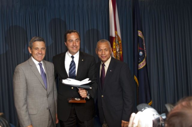"CAPE CANAVERAL, Fla. -- Kennedy Space Center Director Bob Cabana, left, Mark Sirangelo, head of Sierra Nevada Space Systems (SNSS) of Sparks, Nev., and NASA Administrator Charlie Bolden pose for a photo after signing a Space Act Agreement that will offer the company technical capabilities from Kennedy's uniquely skilled work force. Kennedy will help Sierra Nevada with the ground operations support of its lifting body reusable spacecraft called ""Dream Chaser,"" which resembles a smaller version of the space shuttle orbiter.    The spacecraft would carry as many as seven astronauts to the space station. Through the new agreement, Kennedy's work force will use its experience of processing the shuttle fleet for 30 years to help Sierra Nevada define and execute Dream Chaser's launch preparations and post-landing activities. In 2010 and 2011, Sierra Nevada was awarded grants as part of the initiative to stimulate the private sector in developing and demonstrating human spaceflight capabilities for NASA's Commercial Crew Program. The goal of the program, which is based in Florida at Kennedy, is to facilitate the development of a U.S. commercial crew space transportation capability by achieving safe, reliable and cost-effective access to and from the space station and future low Earth orbit destinations. Photo credit: NASA/Jim Grossmann KSC-2011-5119"